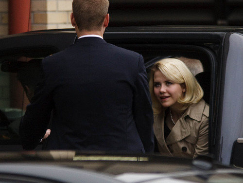 Leah Hogsten  |  The Salt Lake Tribune Elizabeth Smart is escorted into Frank Moss Federal Courthouse in Salt Lake City to testify in the Brian David Mitchell trial on  Wednesday, Nov. 10, 2010.