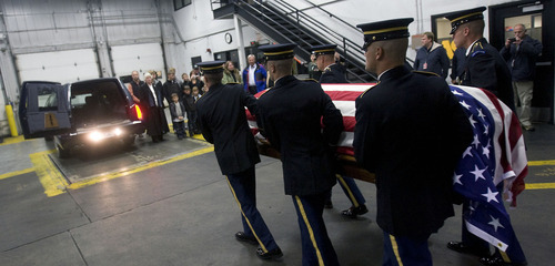 Al Hartmann  |  The Salt Lake Tribune Army honor guard carries casket with the arm and leg bones of  Cpt. George Willard Grismore to a waiting hearse at an air cargo warehouse at the Salt Lake City International Airport on Wednesday morning.  Grismore's plane went down in Leyte, Phillipines on March 12, 1945.  His remains were identified with a dna match from a family member nearly 65 years later.
