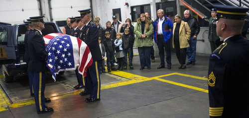 Al Hartmann  |  The Salt Lake Tribune Army honor guard carries a casket with the remains of  Cpt. George Willard Grismore to a waiting hearse at an air cargo warehouse at Salt Lake City International Airport on Wednesday morning.  Grismore's plane went down in Leyte, Phillipines, on March 12, 1945.  His remains were identified using a DNA match from a family member nearly 65 years later.