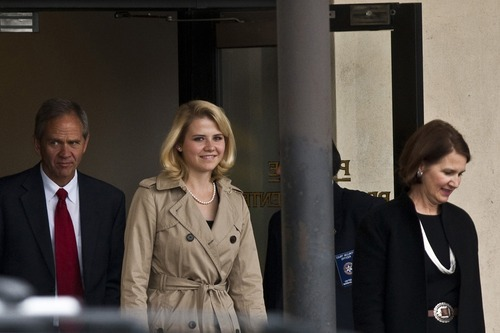 Chris Detrick  |  The Salt Lake Tribune  Elizabeth Smart and her parents, Lois and Ed Smart, walk out of the Federal Courthouse in Salt Lake City during the Brian David Mitchell trial on November 10, 2010.