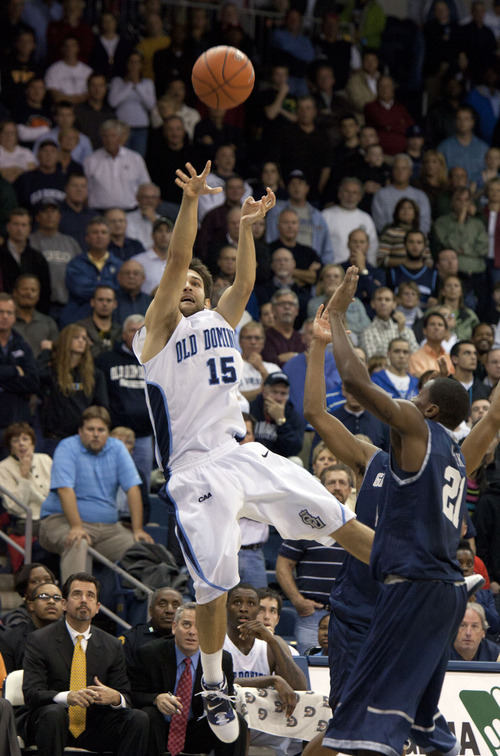 Old Dominion's Trian Iliadis (15) shoots over Georgetown's Jason Clark in the final seconds of their NCAA college basketball game, Friday, Nov. 12, 2010, in Norfolk, Va. The basket did not fall. Georgetown won the game 62-59. (AP Photo/The Virginian-Pilot, Bill Tiernan)