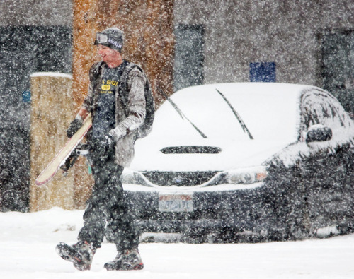 Steve Griffin  |  The Salt Lake Tribune  Chris Waldvogel, of St. George, walks through a blizzard to get to his car in the Brighton ski resort parking lot after he hiked up the slopes to get a few snowboard runs in Tuesday, Oct. 26, 2010. This storm packed a wallop thanks to lake effect, a phenomenon researchers are studying so they can better forecast the snow it will produce.