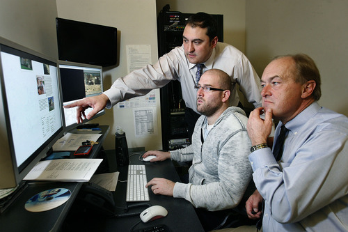 Scott Sommerdorf  l  The Salt Lake Tribune Matt Gephardt (left) confers with his father Bill Gephardt (right) and video editor Scott Sherman (center) about an upcoming