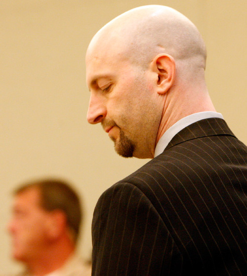 Leah Hogsten  |  The Salt Lake TribuneEugene Christopher Wright shakes his head in disbelief after a jury found him guilty of killing Kenneth Dolezsar.