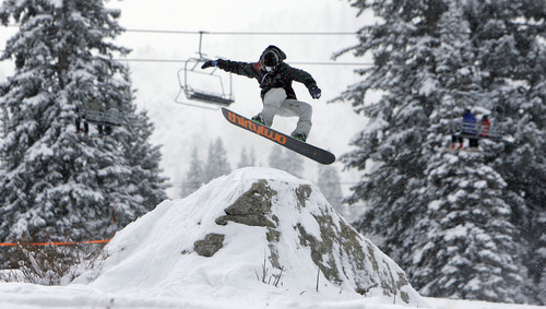 Francisco Kjolseth  |  The Salt Lake Tribune A snowboarder takes to the terrain park for the first day of the 2010-11 ski season on Thursday at Brighton Resort, the first of Utah's 14 active ski areas to open.