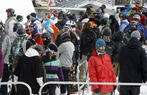 Francisco Kjolseth  |  The Salt Lake Tribune A line of skiers and snowboarders formed Thursday at the base of  Majestic lift at Brighton, the first of Utah's 14 active resorts to open for the 2010-11 ski season.