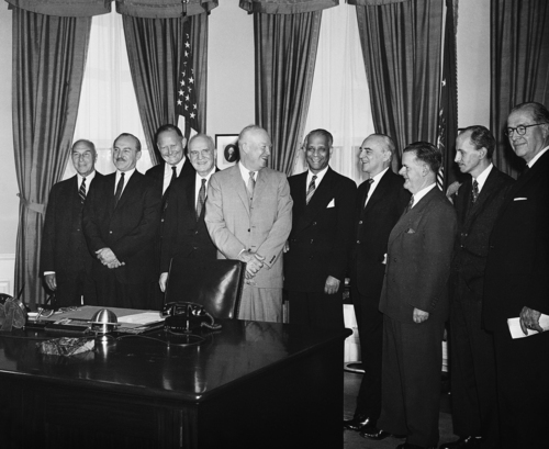 President Dwight Eisenhower chats with delegates to the Food for Peace Conference during a White House visit on May  6, 1959 in Washington.  They are studying ways of getting more wheat to hungry nations.  In group are, from left, Assistant U.S. Treasurer Treasury Secretary Laurence B. Robbins; Douglas Darkness, Canadian Minister of Agriculture; under secretary of state C. Douglas Dillon; Canadian Minister of Commerce Cordon Churchill; The President; B.R. Sen. United Nations FAO group director general; French Ambassador Herve Alphand; Sir John Crawford, Australian Secretary of the Department of Trade; Rafael Garcia-Mata, Argentine undersecretary of Agriculture, and U.S. Agriculture Secretary Ezra Taft Benson. (AP Photo)
