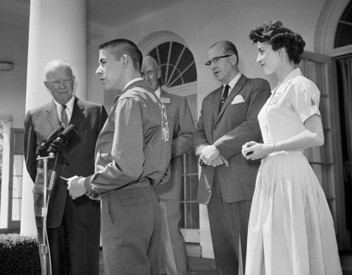 Jimmy McCormick, Crossville, Tenn., reads a National 4-H Club citation to President Eisenhower in the rose garden at the White House, April 25, 1960 in Washington. The President was named a ?Partner-In-4-H.? Brenda Ann Tjaden of Kechi, Kans., right, gave him a ?Partner-In-4-H? tie clasp. Others present in background are C.M. Ferguson, center, Federal Extension Service director, and Agriculture Secretary Ezra Taft Benson. (AP Photo/Bill Allen)