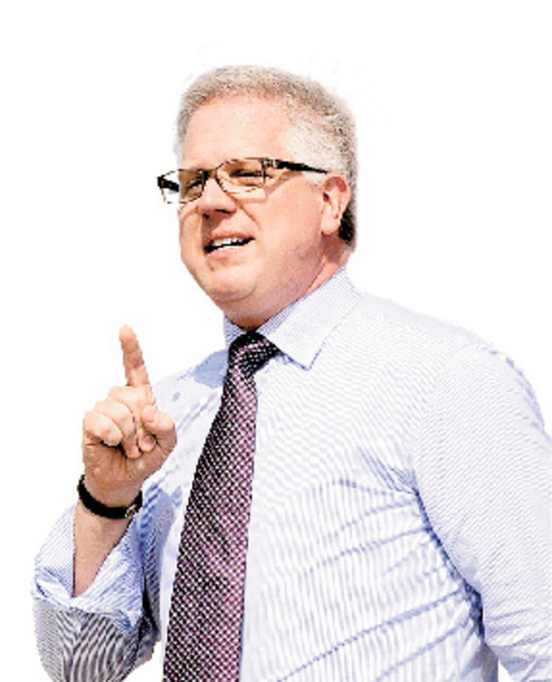 Conservative commentator Glenn Beck speaks to thousands gathered below the steps of the Lincoln Memorial in Washington during the