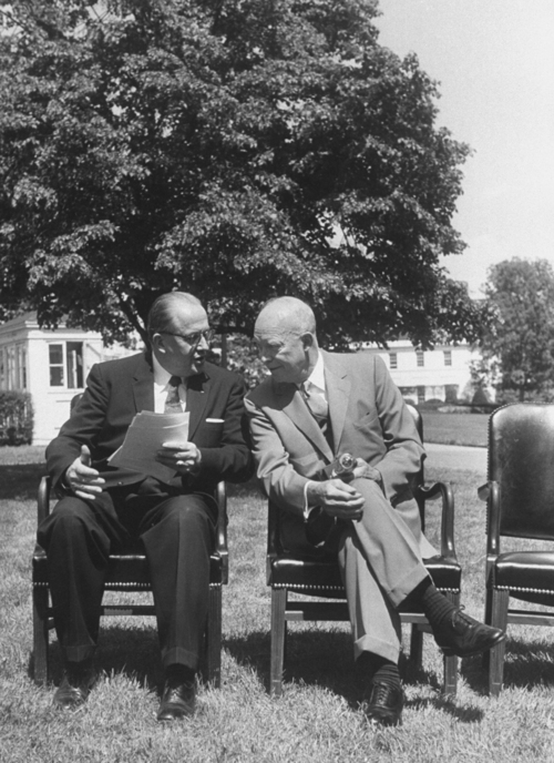 President Dwight D. Eisenhower (L) with Ezra Taft Benson (R) on White House lawn during forest fire award presentation.  (Photo by Ed Clark//Time Life Pictures/Getty Images)