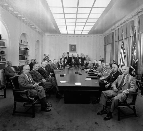 Members of the Eisenhower cabinet pose in the White House cabinet room, Aug. 7, 1959, in Washington. Clockwise around table from left are:  Gerald Morgan, deputy assistant; Amb. Henry Cabot Lodge; Interior Secretary Frederick A. Seaton; Treasury Secretary Robert B. Anderson; Vice President Richard M. Nixon; Atty. Gen. William P. Rogers; Acting Commerce Secretary Frederick H. Mueller; HEW Secretary Arthur S. Flemming; AEC Chairman John A. McCone; Budget Director Maurice Stans; Civil Defense Director Leo A. Hoegh; Labor Secretary James P. Mitchell; Postmaster Gen. Arthur E. Summerfield; Secretary of State Christian Herter; Eisenhower; Defense Secretary Neil McElroy; Agriculture Secretary Ezra Taft Benson; Cabinet Secretary Robert Gray, and Presidential Assistant Wilton Persons. In rear are, from left Graydon Upton, assistant treasury secretary; Philip Schaffner of treasury dept.; presidential assistants Bryce Harlow, Don Paarlberg, David Kendall, Robert Merriam, Edward McCabe and Jack Anderson, and Under Secretary of State C. Douglas Dillon. (AP Photo/William J. Smith)