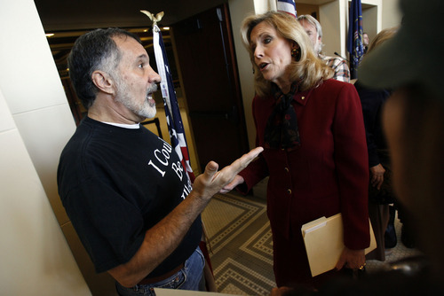 Francisco Kjolseth  |  The Salt Lake Tribune Michael Picardi with the Coalition of Utah Progressives argues with Cheryl Eager of the American Leadership Fund following a press conference by the Utah Coalition On Illegal Immigration where Rep. Stephen Sandstrom spoke about his illegal immigration bill. Salt Lake City Nov. 17, 2010.