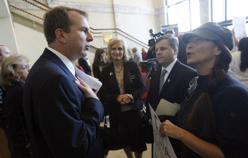 Francisco Kjolseth  |  The Salt Lake Tribune Rep. Chris Herrod argues with Peggy Wilson who asked him why he doesn't use E-Verify for his business as the two attended a press conference by Rep. Stephen Sandstrom who spoke about his immigration bill at the Utah State Capitol.  Salt Lake City Nov. 17, 2010.