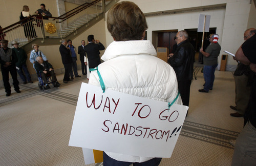 Francisco Kjolseth  |  The Salt Lake Tribune Marita Marinaro, originally from Uruguay who now lives in American Fork lends her support for Rep. Stephen Sandstrom and his immigration bill as people start to gather for a press conference at the Utah State Capitol. Salt Lake City Nov. 17, 2010.