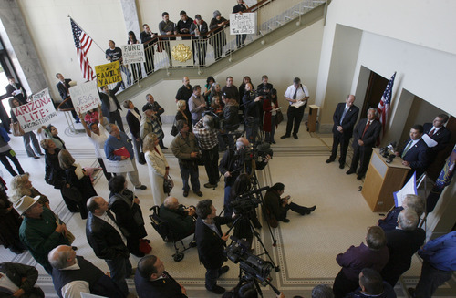 Francisco Kjolseth  |  The Salt Lake Tribune Rep. Sandstrom, far right, holds a press conference at the Utah State Capitol to express his enforcement-only illegal immigration bill is in line with the guiding prinicples of the Utah Compact while surrounded by supporters and opponents to bill.  Salt Lake City Nov. 17, 2010.