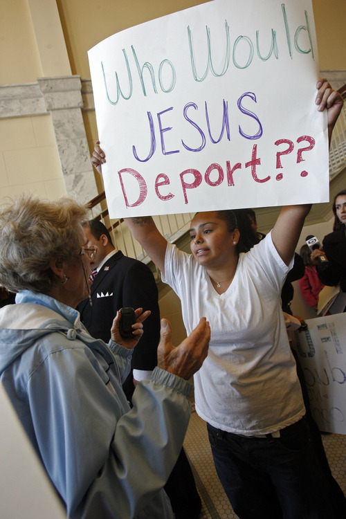 Francisco Kjolseth  |  The Salt Lake Tribune Nellie Morgan, left, and Nadia Rivera argue over how illegal immigration should be enforced following a press conference by Rep. Stephen Sandstromat the Utah State Capitol.   Salt Lake City Nov. 17, 2010.