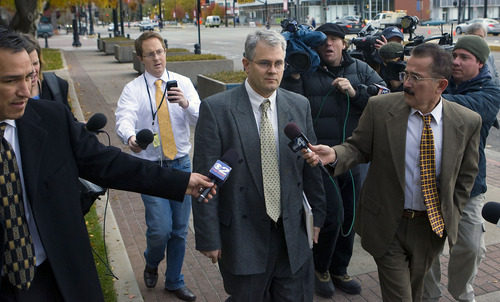 Al Hartmann     The Salt Lake Tribune Tim Mitchell, brother of Brian David Mitchell, center,  leaves the Frank Moss Federal Courthouse in Salt Lake City on Thursday, Nov. 17.  He testified for the defense.  He had no comments for the media.