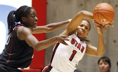 Stanford forward Chiney Ogwumike (13) defends against Utah guard Janita Badon (1) during the first half of their NCAA  college basketball game Friday, Nov. 19, 2010, in Salt Lake City.  (AP Photo/Jim Urquhart)