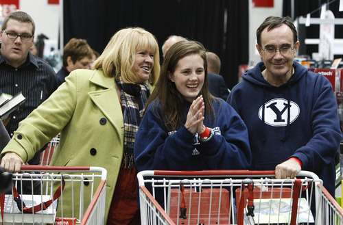 Leah Hogsten  |  The Salt Lake Tribune Ruth Ellis, left, Courtney Kennard and her father Terry Kennard are all smiles after receiving their signed books Friday from former President George W. Bush. Bush spent about two hours at Costco in Sandy signing his new book,