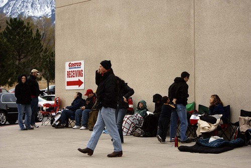 Trent Nelson  |  The Salt Lake Tribune Hundreds of people were in line at dawn at Costco in Sandy on Friday, Nov. 19, 2010, waiting to have a book signed by former President George W. Bush. By 7 a.m., the line reached most of the way around the building.