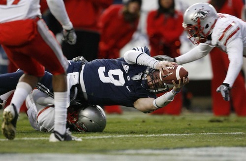 Trent Nelson  |  The Salt Lake Tribune BYU quarterback Jake Heaps (9) dives for a first down, and nearly a touchdown during the first half,  BYU vs. New Mexico, Saturday, November 20, 2010.