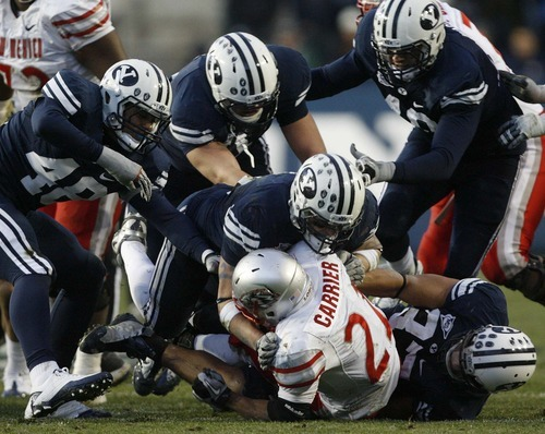 Trent Nelson  |  The Salt Lake Tribune BYU defenders bring down New Mexico's Kasey Carrier during the first half,  BYU vs. New Mexico, Saturday, November 20, 2010.