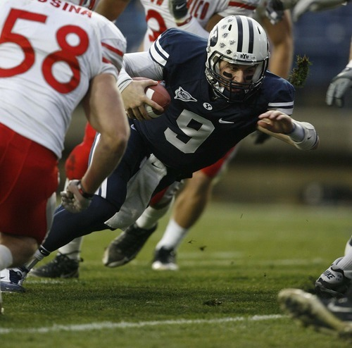 Trent Nelson  |  The Salt Lake Tribune BYU quarterback Jake Heaps (9) runs for a touchdown during the first half,  BYU vs. New Mexico, Saturday, November 20, 2010.