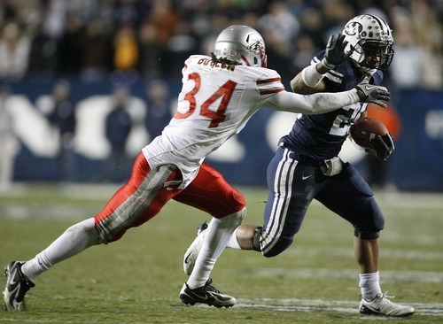 Trent Nelson  |  The Salt Lake Tribune BYU running back Joshua Quezada (20) runs the ball, with New Mexico's A.J. Butler defending in the second half,  BYU vs. New Mexico, Saturday, November 20, 2010.