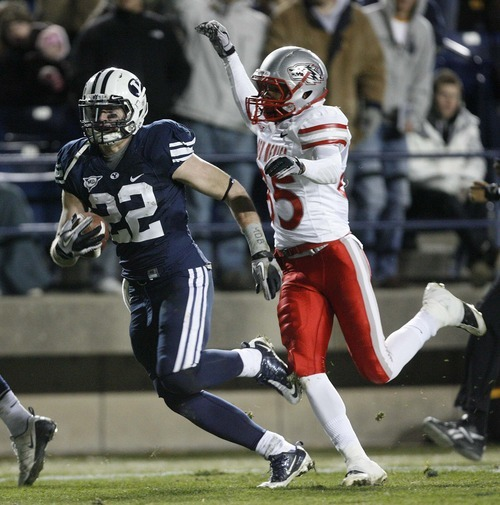 Trent Nelson  |  The Salt Lake Tribune BYU defensive back Andrew Rich (22) runs downfield after intercepting the ball in the second half,  BYU vs. New Mexico, Saturday, November 20, 2010.