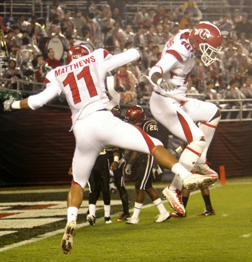 Utah's Luke Matthews and DeVonte Christopher celebrate after Matthews 58 yard touchdown reception in the second quarter of a NCAA college football game Saturday, Nov. 20, 2010, in San Diego. (AP Photo/Lenny Ignelzi)