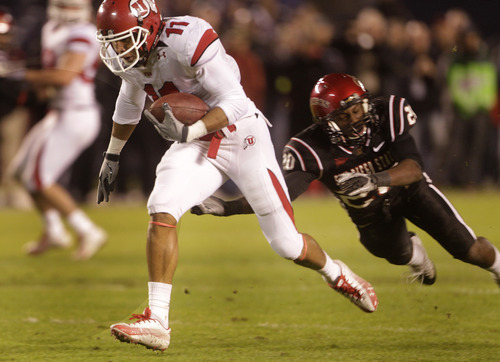 Utah's Luke Matthews leaves San Diego State's Nat Berhe in his wake while converting a 57 yard touchdown pass  during the second quarter of a NCAA college football game Saturday, Nov. 20, 2010, in San Diego. (AP Photo/Lenny Ignelzi)