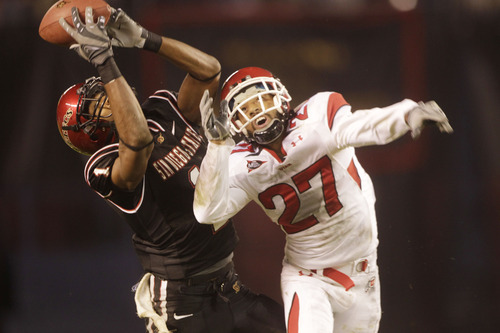 San Diego State's DeMarco Sampson pulls in a pass against the defense of Utah's Brandon Burton for a 44 hard gain during the second quarter of a NCAA college football game Saturday, Nov. 20, 2010, in San Diego. (AP Photo/Lenny Ignelzi)