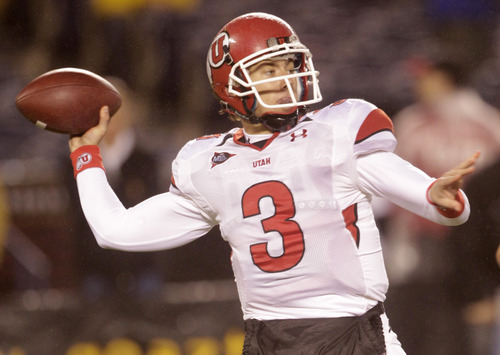 Utah quarterback Jordan Wynn fires a pass in the first quarter against San Diego State during the first half of a NCAA college football game Saturday, Nov. 20, 2010, in San Diego. Wynn threw for 283 yards and two touchdowns  in the first half.   (AP Photo/Lenny Ignelzi)