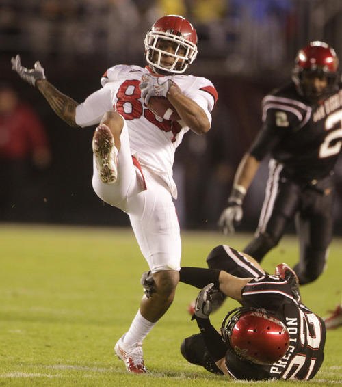 Utah's Jereme Brooks is dropped for a loss by San Diego State's Andrew Preston after catching a pass during the first half of a NCAA college football game Saturday, Nov. 20, 2010, in San Diego. (AP Photo/Lenny Ignelzi)