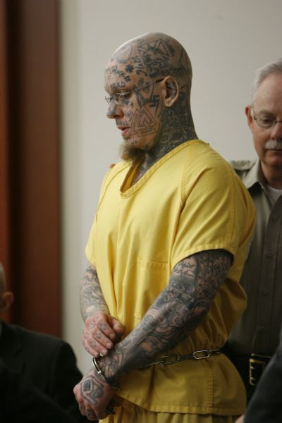 Francisco Kjolseth  | Tribune file photo Curtis Allgier is charged with capital murder and seven other felonies for the June, 25, 2007, slaying of 60-year-old prison Officer Stephen Anderson. Allgier's lawyers want his tattoos covered up during his trial to avoid prejudicing the jury.
