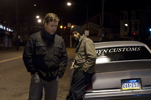 In this film publicity image released by Lionsgate, Russell Crowe, left, and Rza are shown in a scene from