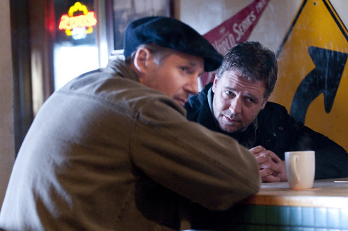 In this film publicity image released by Lionsgate, Liam Neeson, left, and Russell Crowe are shown in a scene from