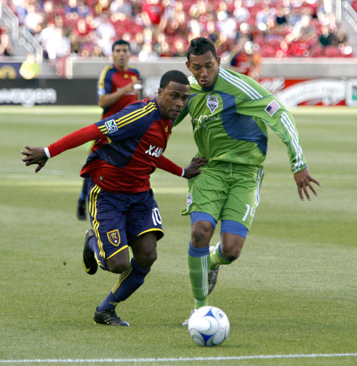 Real Salt Lake's Robbie Findley works past Seattle defender Tyrone Marshall. Stephen Holt/Special to the Tribune