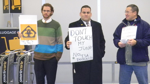 Tom Wharton     The Salt Lake Tribune Protesters, from left, Caleb Christian, of Orem; Keith Kuder, of Orem, and Dave Chiu, of Provo, gathered on  Wednesday at Salt Lake International Airport to protest security requirements for air travelers.