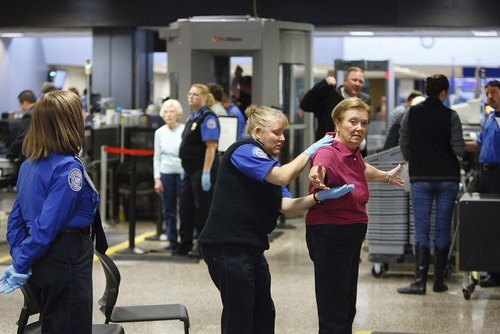 Trent Nelson  |  The Salt Lake Tribune Thayre Dennis was patted down by a TSA agent at a security checkpoint in the Salt Lake International Airport, Tuesday, November 23, 2010.