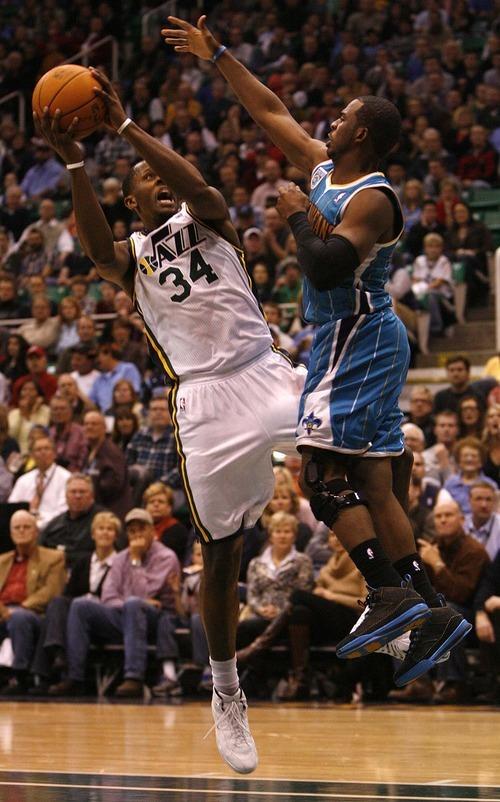 Trent Nelson  |  The Salt Lake Tribune Utah Jazz forward C.J. Miles (34) is fouled by New Orleans guard Chris Paul (3). Utah Jazz vs. New Orleans Hornets, NBA basketball at EnergySolutions Arena Wednesday, November 24, 2010.