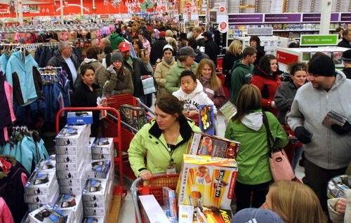 Rick Egan  | The Salt Lake Tribune Early morning shoppers try to make their way down the crowded aisles at the Super Target in Midvale Friday. Shoppers started lining up at 7 p.m. on Thursday for the store's 4 a.m. opening.