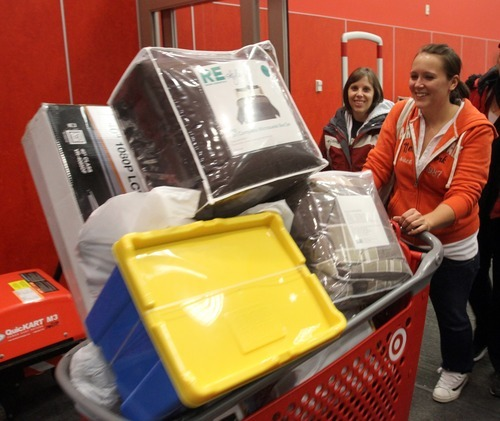 Rick Egan  | The Salt Lake Tribune Megan Goodrich, of Salt Lake City, was able to find everything she wanted at the 4 a.m. opening of the Super Target in Midvale  Friday. Shoppers started lining up at 7 p.m. on Thursday.