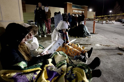 Trent Nelson | The Salt Lake Tribune Rachel Bye, Shannon Stucki and Jennifer Neujahr were among hundreds of shoppers who braved subfreezing temperatures Thursday while waiting in line to get into South Towne Center at midnight to kick off Black Friday.