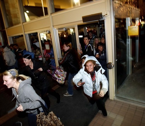 Trent Nelson | The Salt Lake Tribune Shoppers stream into South Towne Center at midnight Friday to kick off Black Friday.