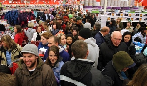 Rick Egan | The Salt Lake Tribune Early morning shoppers fight their way down the crowded aisles at the Super Target in Midvale Friday. Shoppers started lining up at 7 p.m. on Thursday for the 4 a.m. opening of the store.