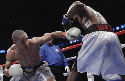 Andre Ward, left, punches Sakio Bika during the ninth round of their WBA super middleweight championship boxing fight in Oakland, Calif., Saturday, Nov. 27, 2010. Ward won by unanimous decision to retain his title. (AP Photo/Jeff Chiu)