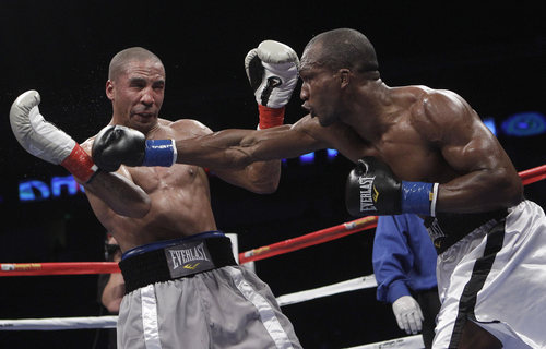 Sakio Bika, right, throws a punch at Andre Ward during the fourth round of their WBA super middleweight championship boxing match in Oakland, Calif., Saturday, Nov. 27, 2010. Ward won by unanimous decision to retain his title. (AP Photo/Jeff Chiu)