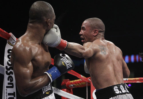 Andre Ward, right, punches Sakio Bika during the third round of their WBA super middleweight championship boxing bout in Oakland, Calif., Saturday, Nov. 27, 2010. Ward won by unanimous decision to retain his title. (AP Photo/Jeff Chiu)