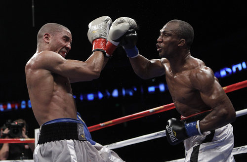 Sakio Bika, right, throws a punch at Andre Ward during the eighth round of their WBA super middleweight championship boxing fight in Oakland, Calif., Saturday, Nov. 27, 2010. Ward won by unanimous decision to retain his title. (AP Photo/Jeff Chiu)